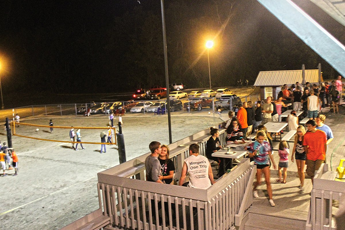 Teens enjoying the deck and volleyball courts