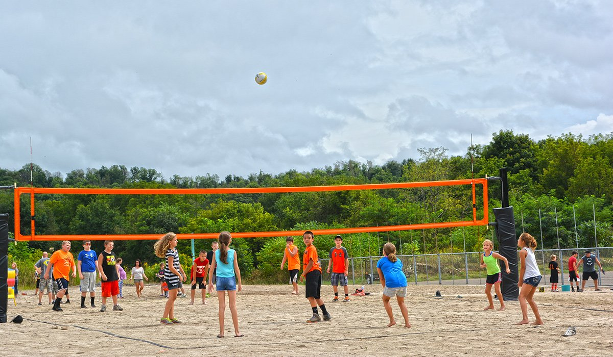 Kids enjoying the volleyball courts